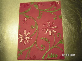 I used a Cuttlebug folder (Stylized Flowers) and embossing pens and powders to create this look.